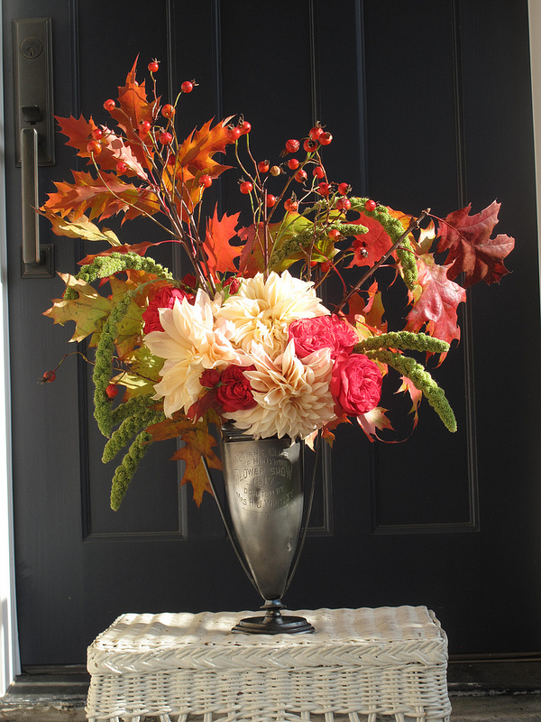 An autumn bouquet of roses, dahlias, millet, oak foliage, and rose hips designed by Prinzing. Photo courtesy of Debra Prinzing.