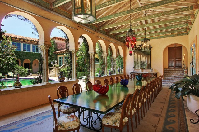 Relaxed luxury alfresco: A breathtakingly dreamy loggia in an amalgam of Mediterranean and Moroccan styles with enough seating for the ultimate open-air feast at a private estate in the glitzy island enclave of Palm Beachm Fla. Photo courtesy of VHT.