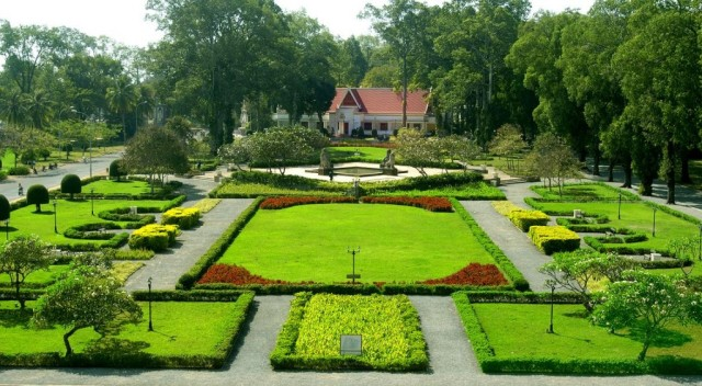 The garden in front of Raffles Grand Hotel d'Angkor in Siem Reap, Cambodia. Photo courtesy of Kiwi Collection.