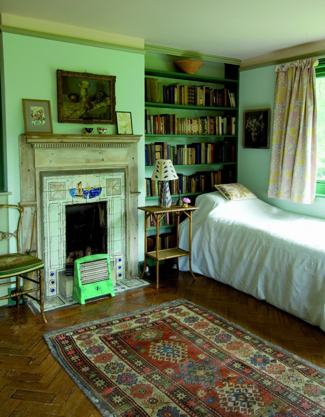 Virginia Woolf's bedroom at Monk's House. Tiled fireplace with lighthouse and boat drawings by Vanessa Bell, her sister.