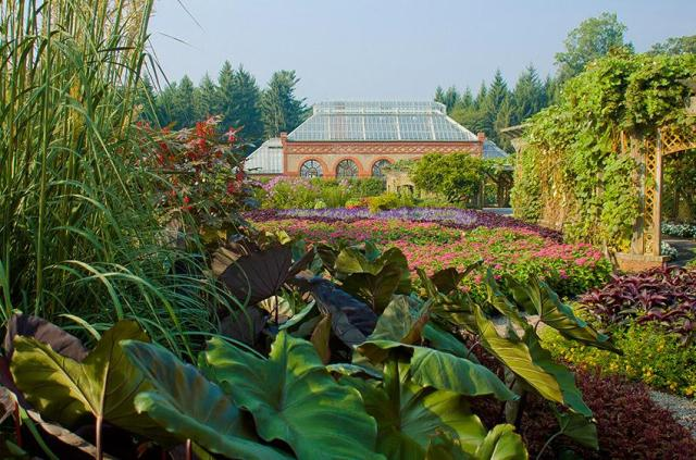 Lush plantings with the Biltmore Conservatory in the distance. Photo courtesy of Biltmore.