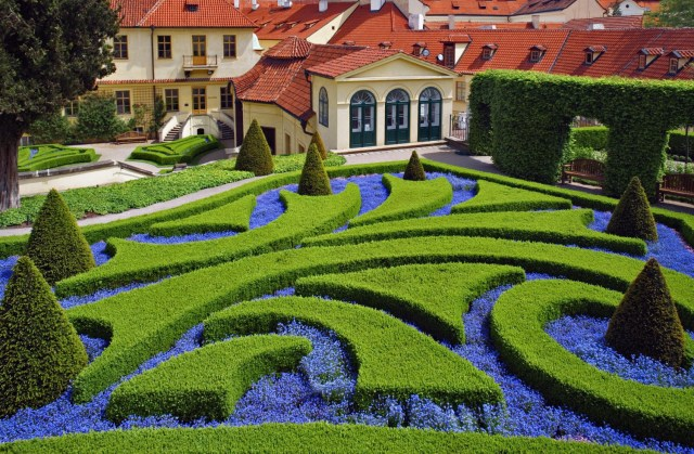 A formal garden with curved lines in a traditional-style new residential development in the Czech Republic. Photo courtesy of Root Fun.
