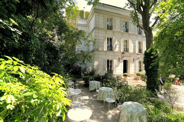 The garden of Hotel Particulier Montmartre in Paris, a Victorian-era estate-turned—hotel—it once belonged to the Rothschild banking and Hermès fashion families—which has vegetable beds, chicken coops and produces honey on-site for the hotel's kitchen.