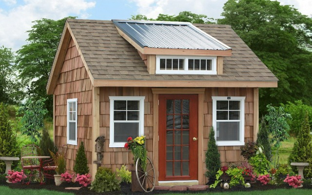 A cedar shake garden shed by Sheds Unlimited.