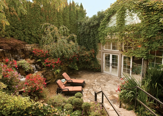 An intimate garden at Queen's Landing, a fine Georgian-style hotel set where the Niagara River meets Lake Ontario. Photo courtesy of Vintage Hotels.